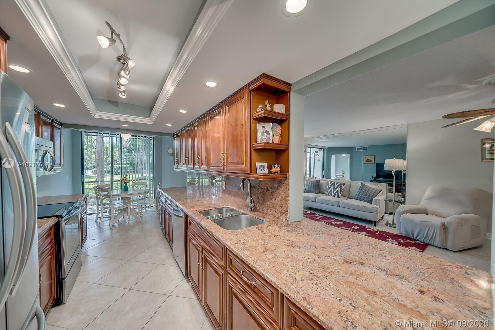 Luxuriously renovated, bright & spacious! This 1st floor unit features a stunning kitchen w/ granite