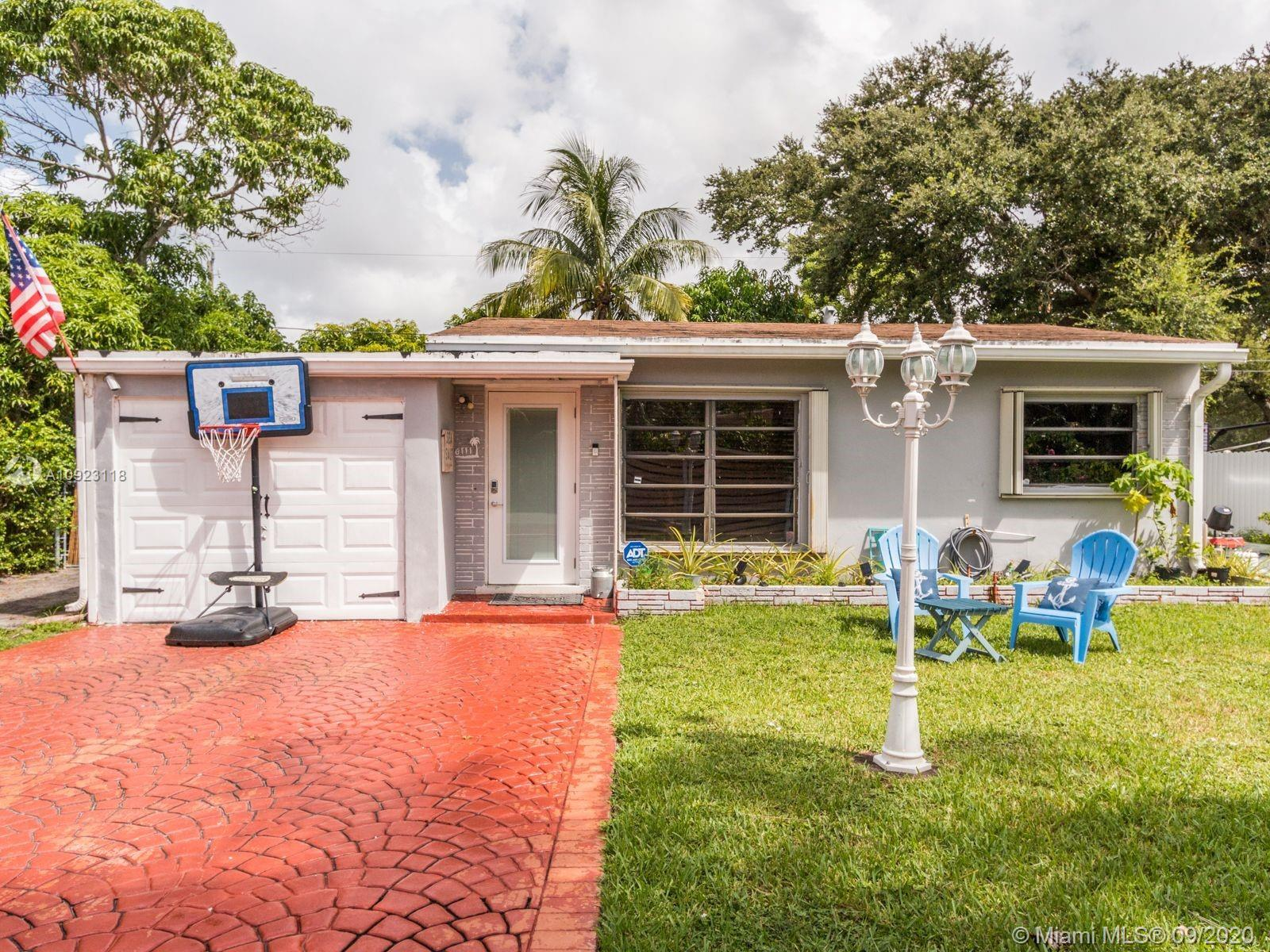 A true doll house completely renovated with ample natural lighting.  Completely fenced private huge