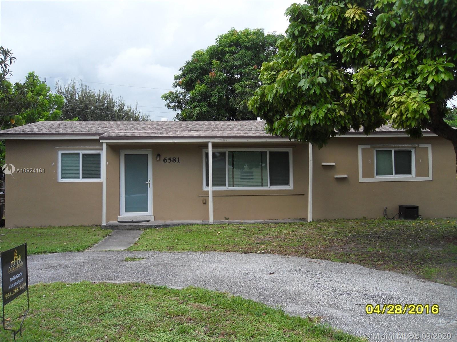 Marvelous and spacious 3 bedroom 2 bath home located in Hollywood. A must see. tiles throughout the