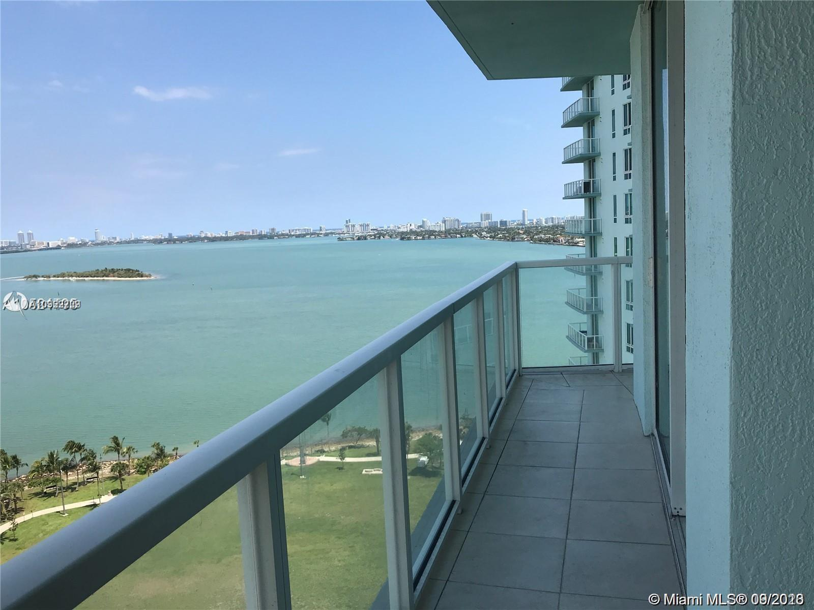 Breathtaking views of Biscayne Bay, the ocean and surrounding areas. Beautifully designed 2 bed + DE