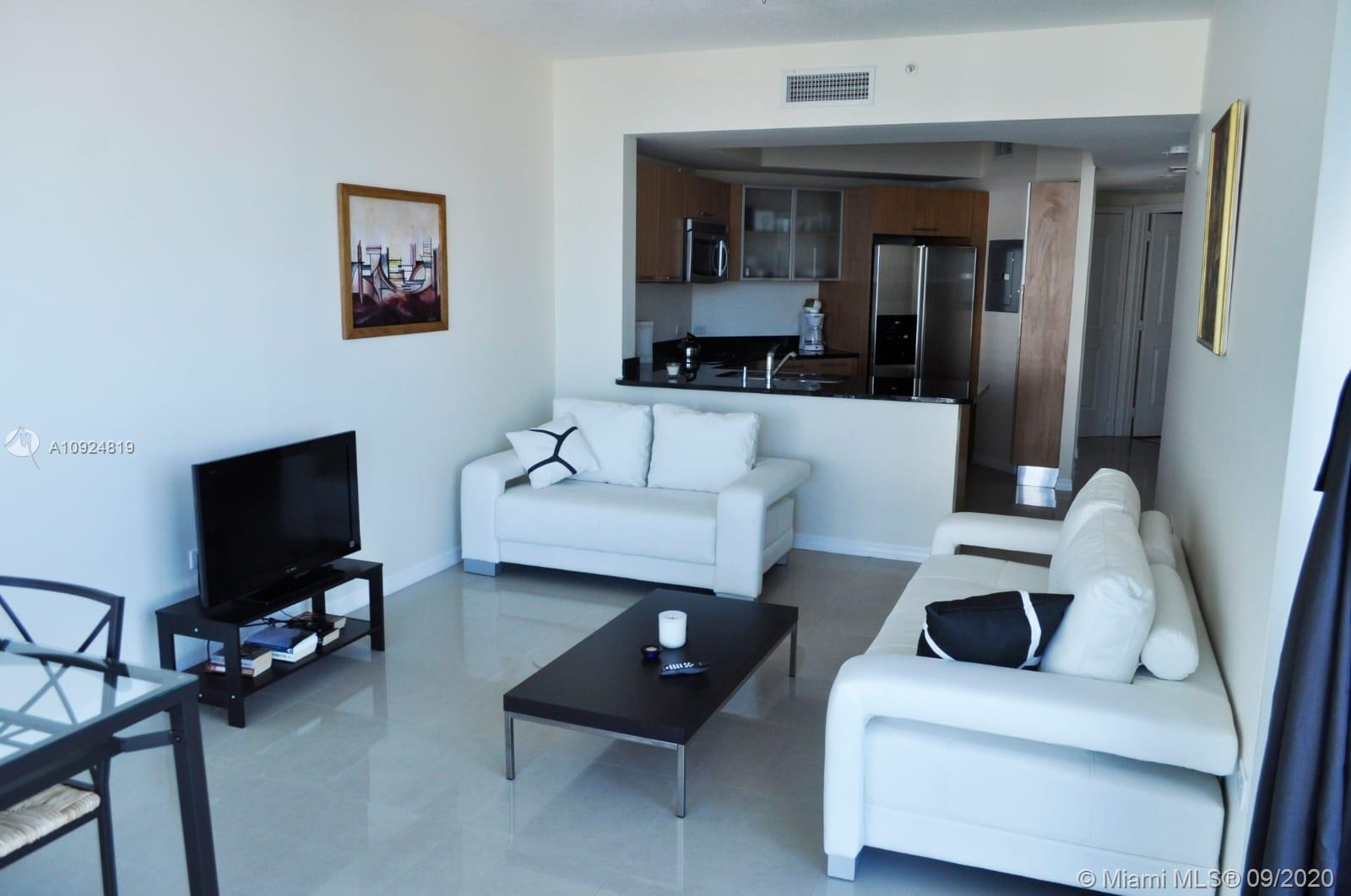 COMPLETELY UPGRADED UNIT WITH MARBLE FLOORS, TOP OF THE LINE STAINLESS STEEL APLLIANCES, MARBLE BATH