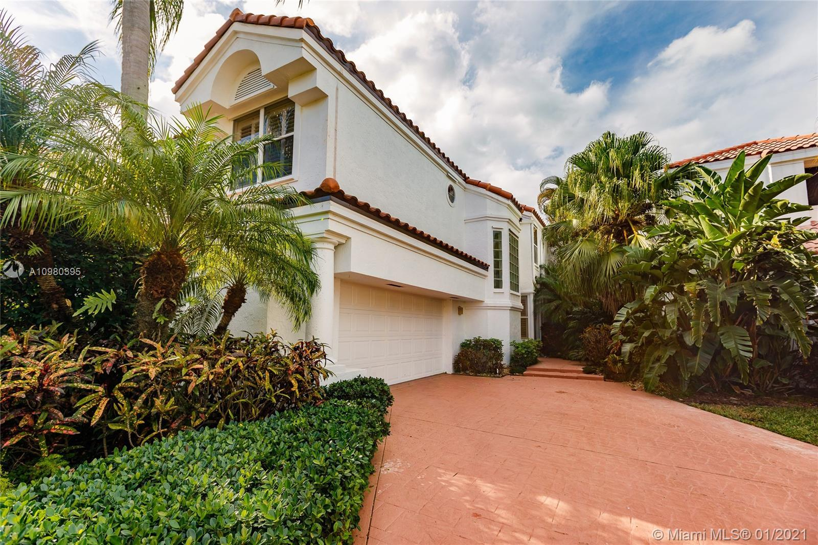 Tastefully renovated 4 Bedroom home + office, overlooking the picturesque 18th hole of the Boca Rato