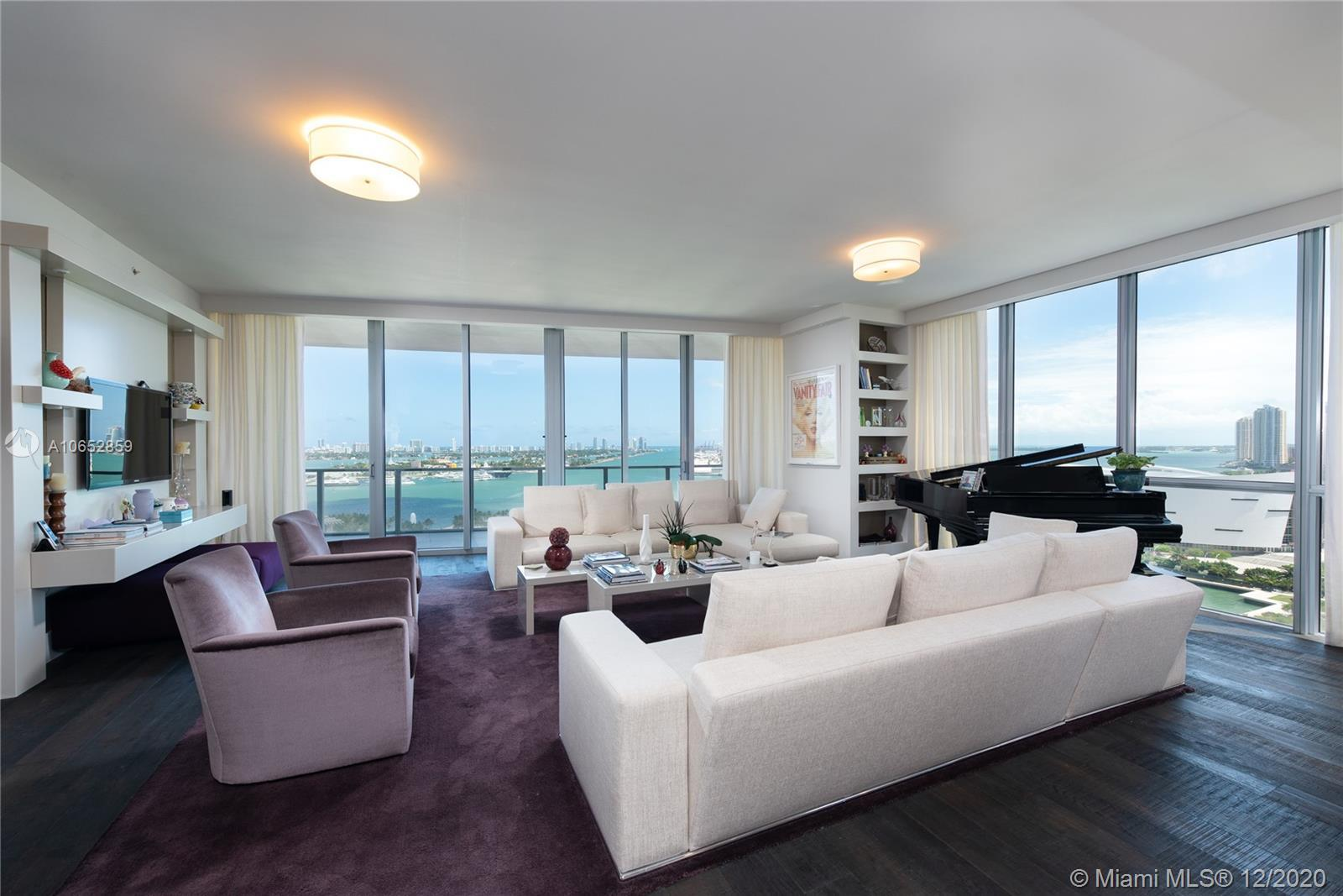 Accessed by private elevator, this southeast corner unit has luxurious finishes that set it apart fr