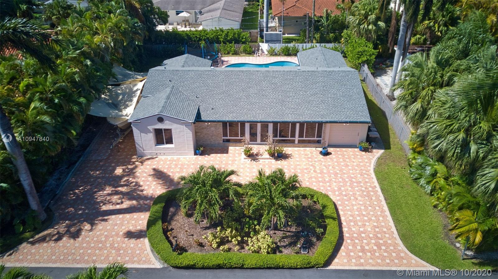 Stunning home with all the features desired in the Enclave Guard gated community of North Bay island