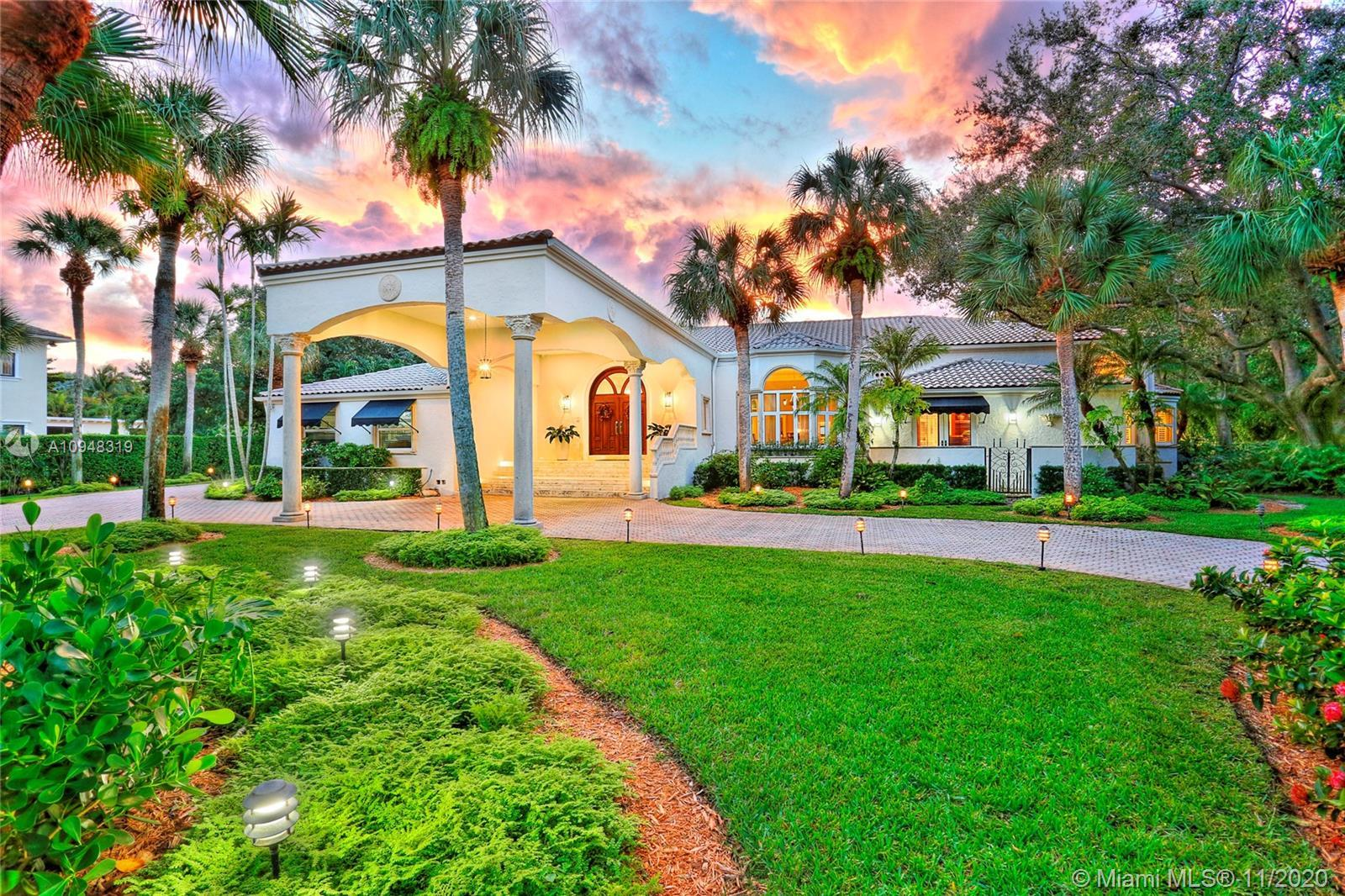 Situated on a prestigious street in Pinecrest, find this custom-built home that sits on a 61,000 sf