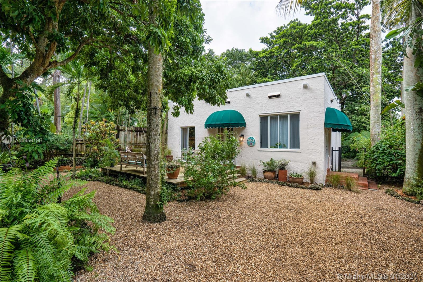Lovely Spanish-style home in coveted South Coconut Grove. 2 bedroom/2 full bath on extra large lot l