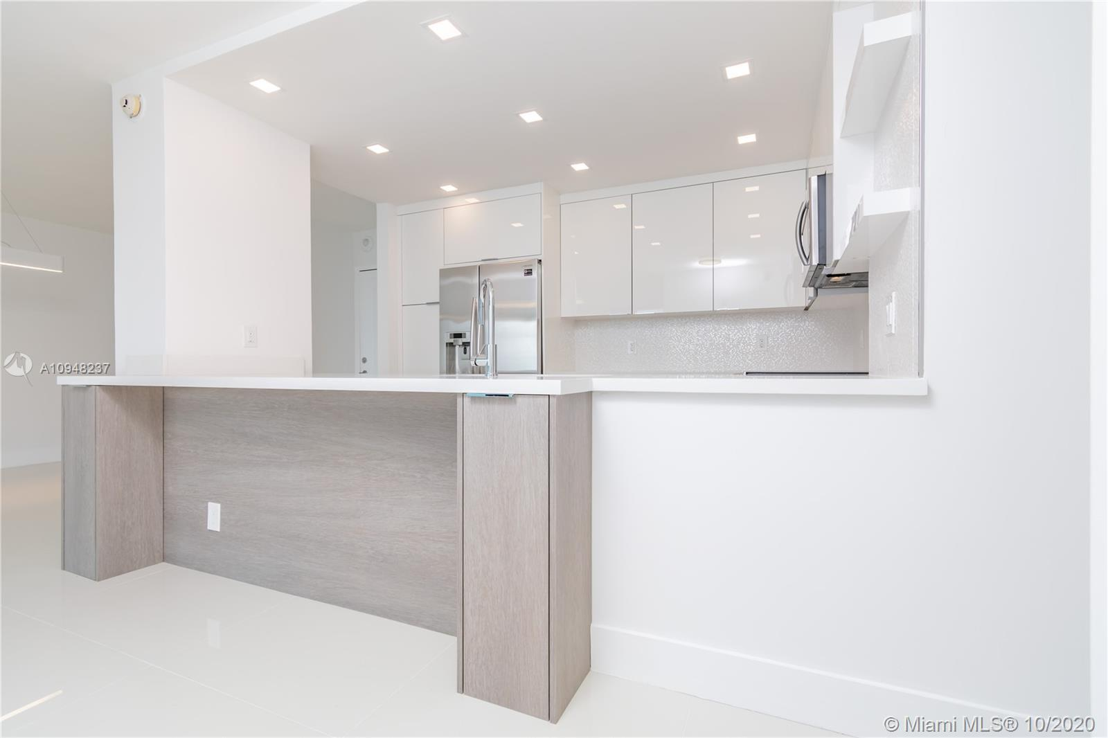 The most BEAUTIFUL 2/2 unit in Arlen House East. SPACIOUS living / dining room area opens up to a la