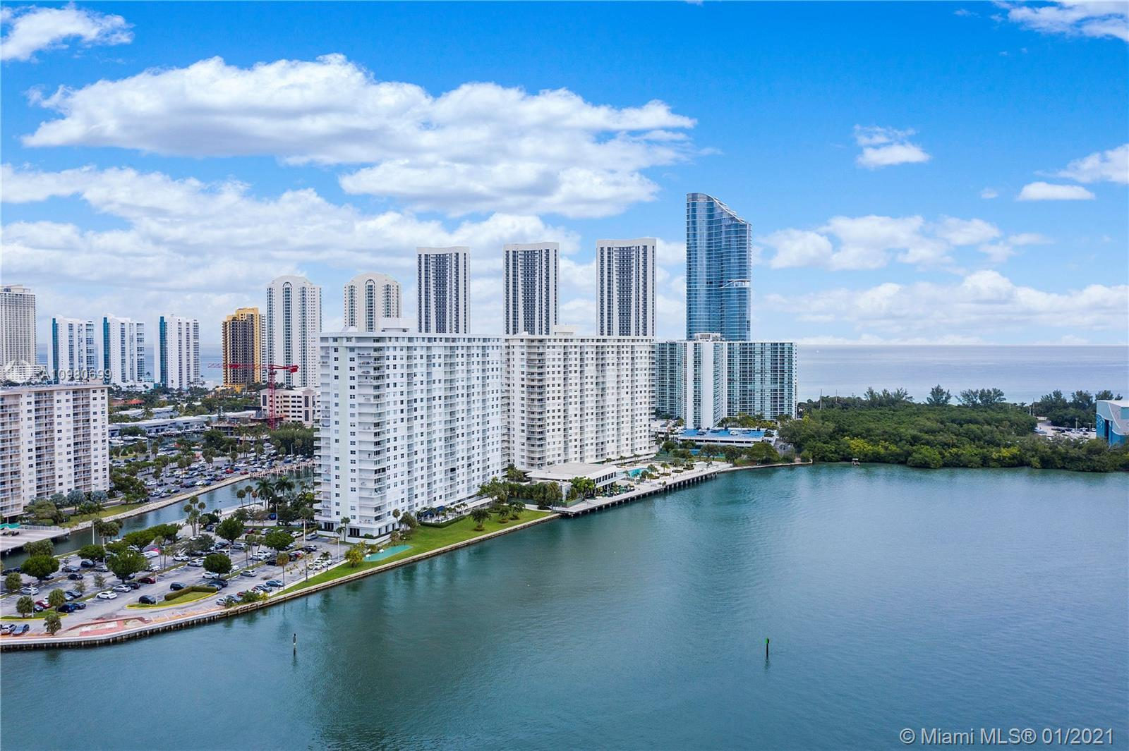 Live in Florida's Riviera & soak up the sun from this  spectacular condo with amazing wide water vie