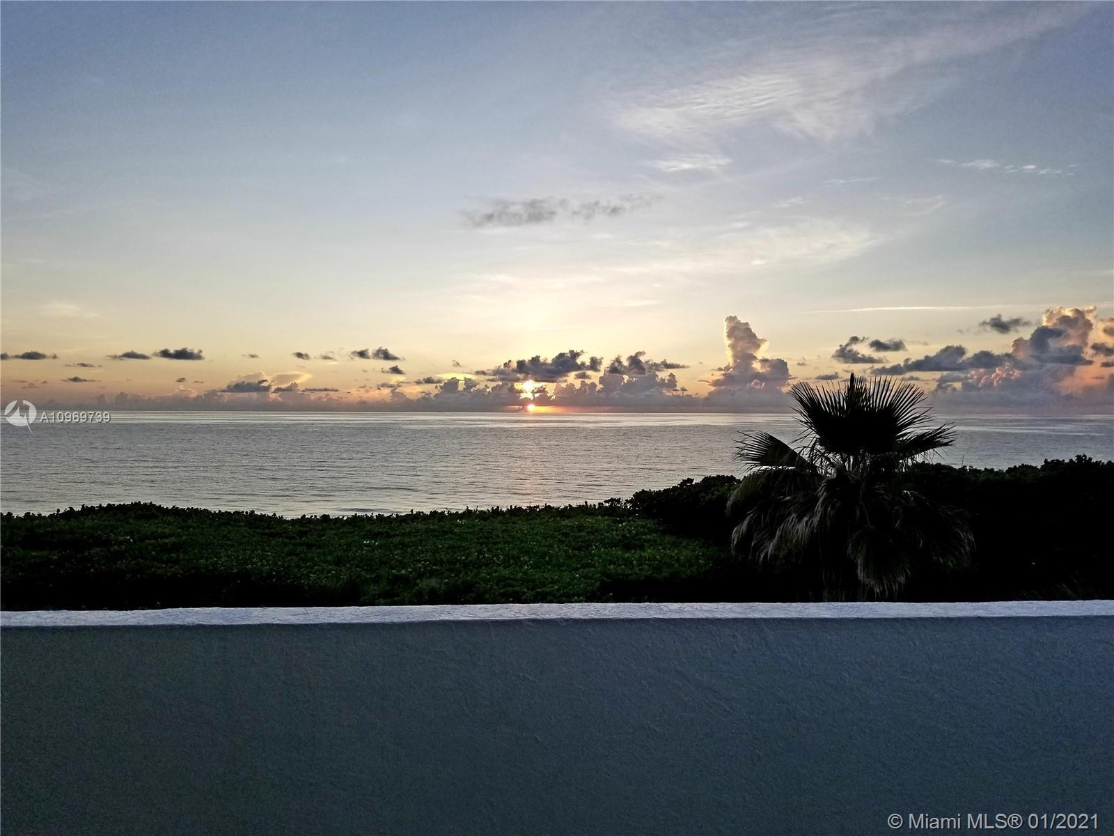 One of a kind that must be seen!  Ocean front, multiple balconies, 4 car garage and a carport, eleva