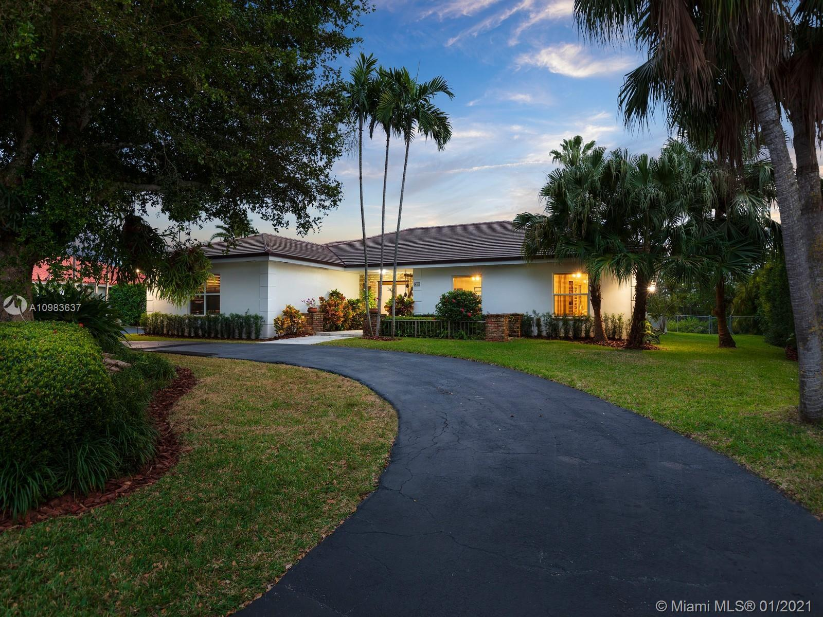 Enchanting one-story canal front home located in the guard gated community of Hammock Oaks. This tra