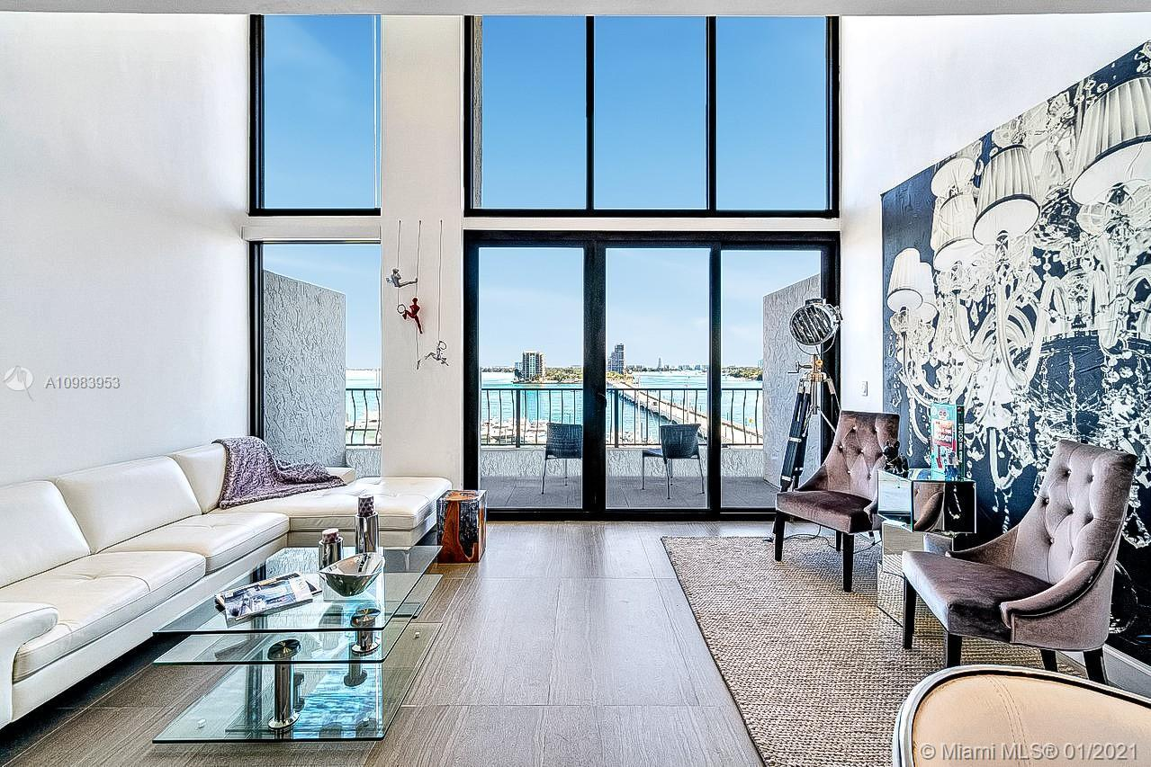 Designer remodeled Direct Waterfront Loft w/ 17ft Ceilings, ultra high-end finishes and floor to cei