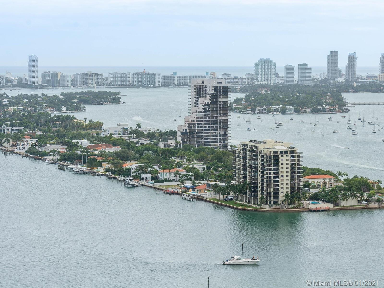 The best of Biscayne Bay water and park front living awaits in this delightfully spacious and stunni