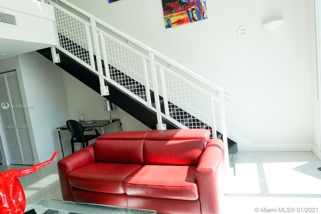 NY Loft Style with skyline views. Fully Furnished apartment. The unit has soaring ceilings, 1/2 bath