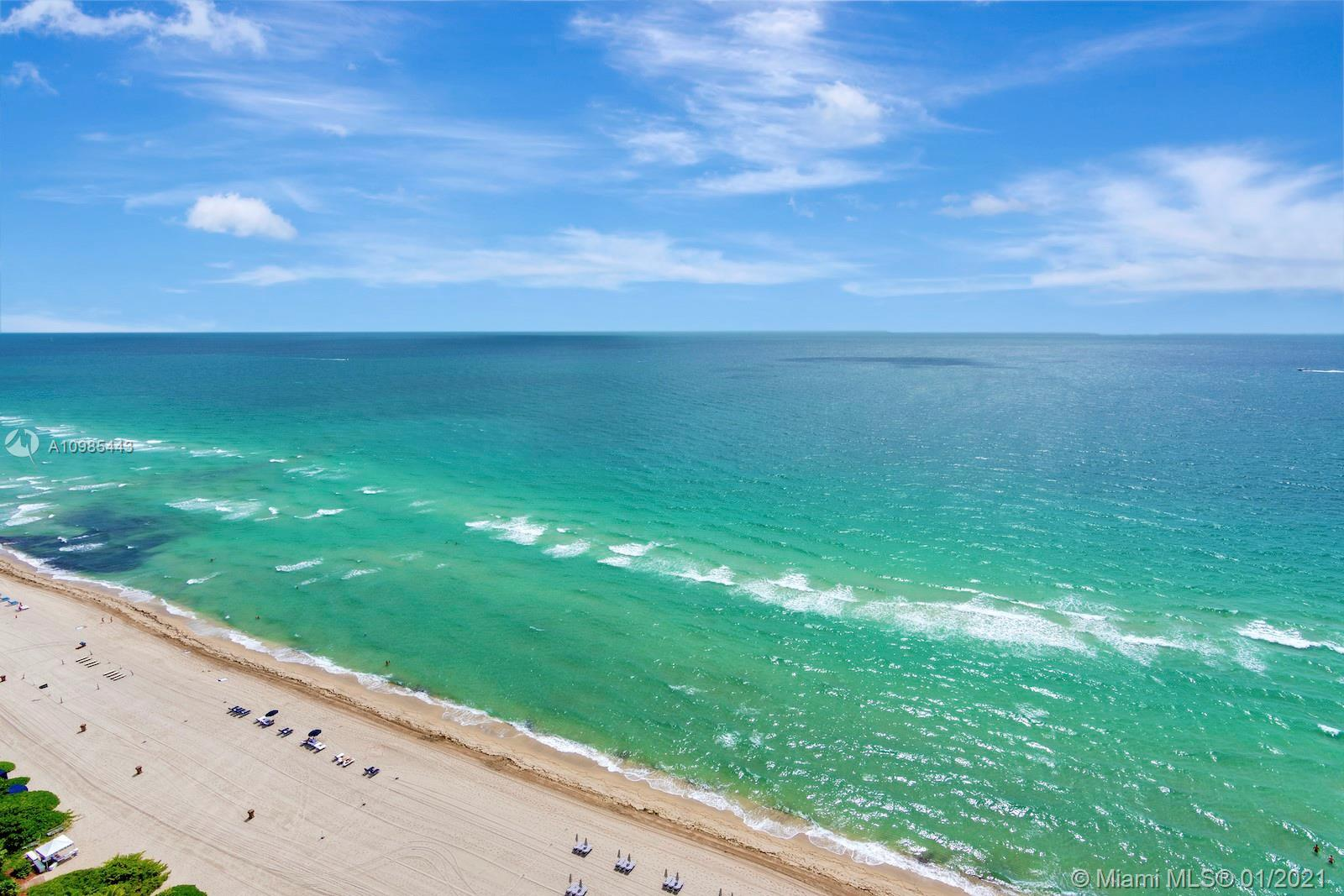 Magnificent ocean and city views in this spectacular beach front 3bed 3.5bad corner unit featuring u