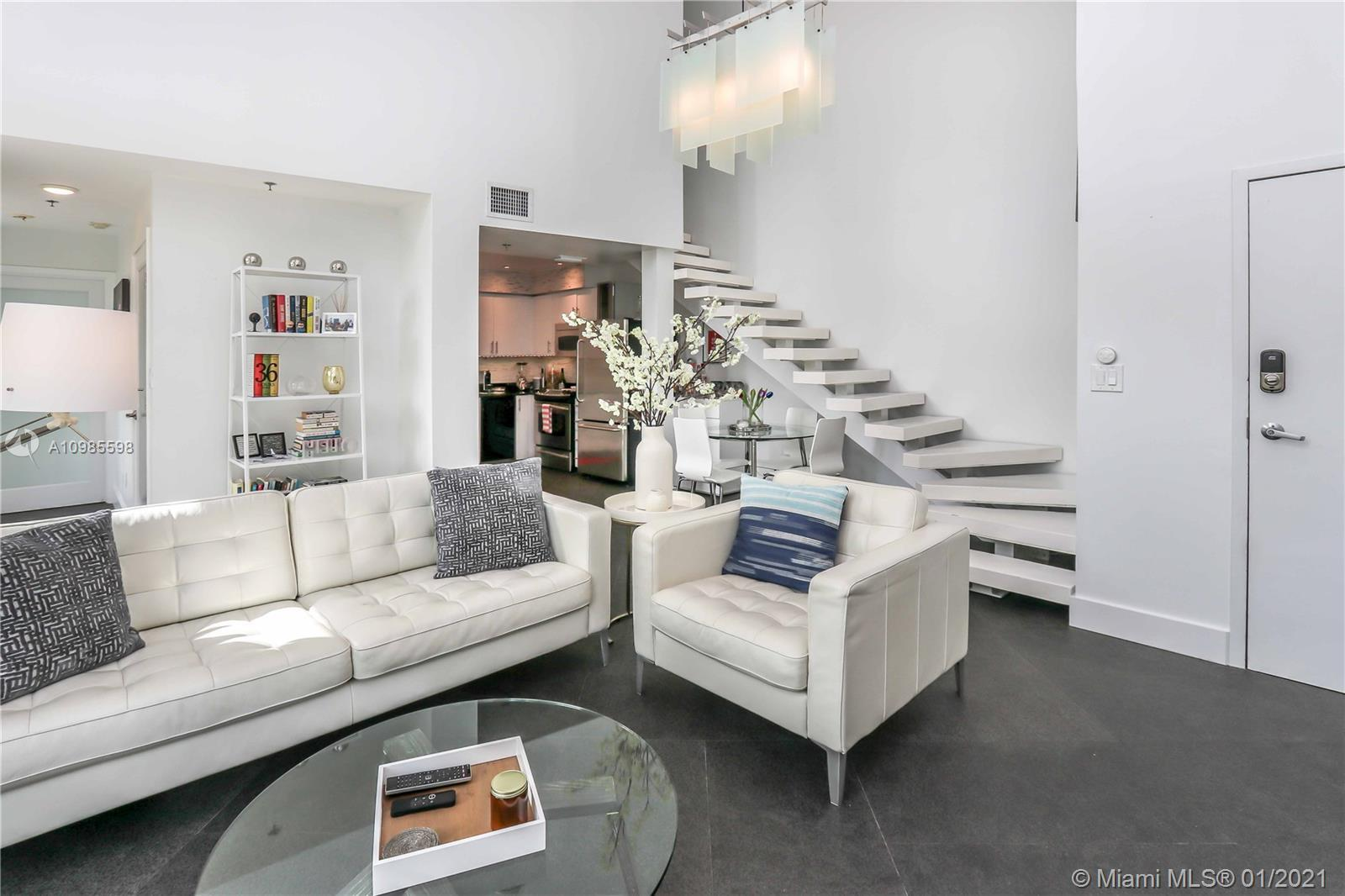 Private two story loft-condo in the heart of South Beach. This unit features double height ceilings,