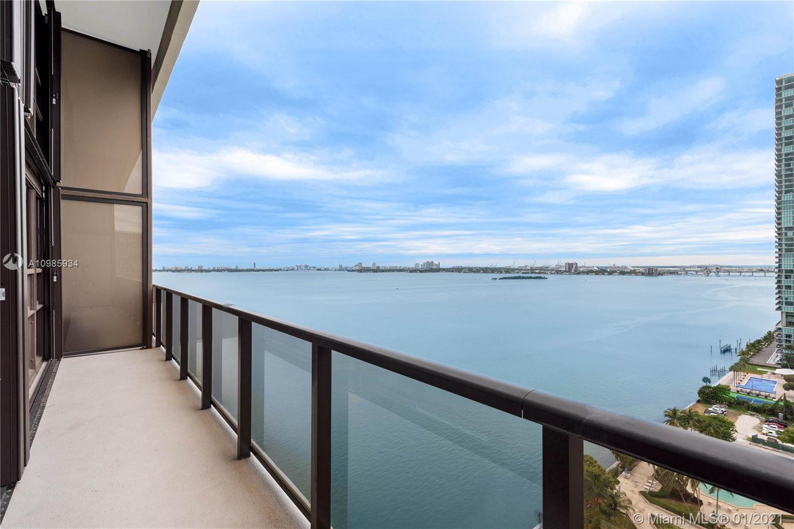 Come home to this impeccably maintained duplex penthouse with stunning panoramic views of the azure