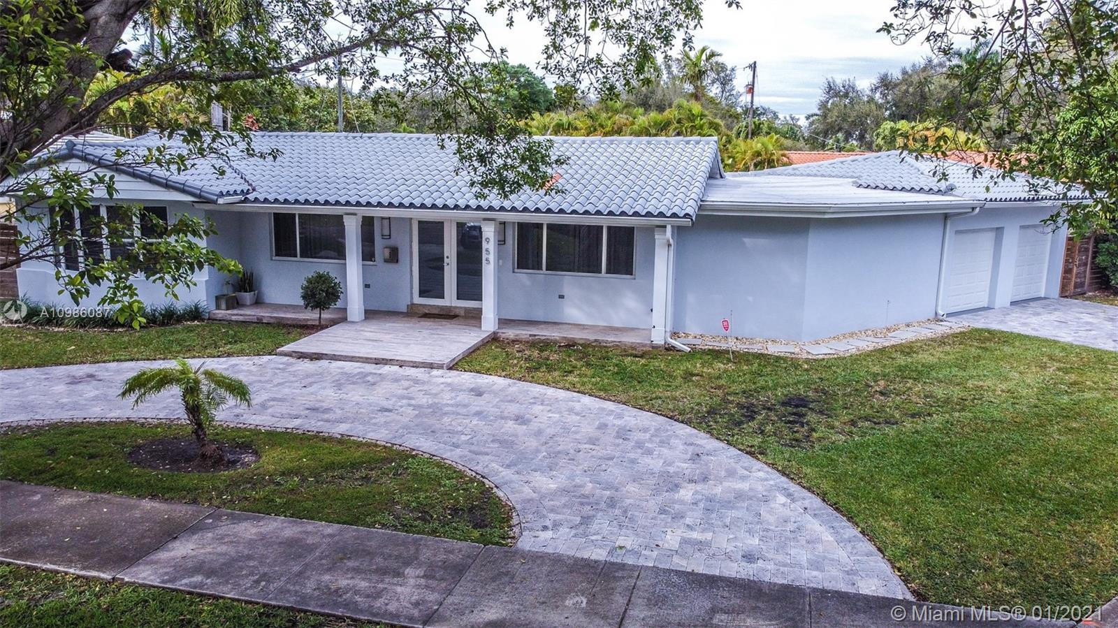 This one of a kind renovated masterpiece sits in the Country Club of Miami shores at the end of a cu