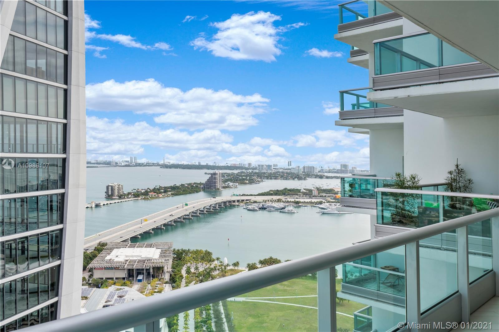 Super clean unit with city, bay and ocean views at 900 Biscayne. Marble countertops/island and fresh