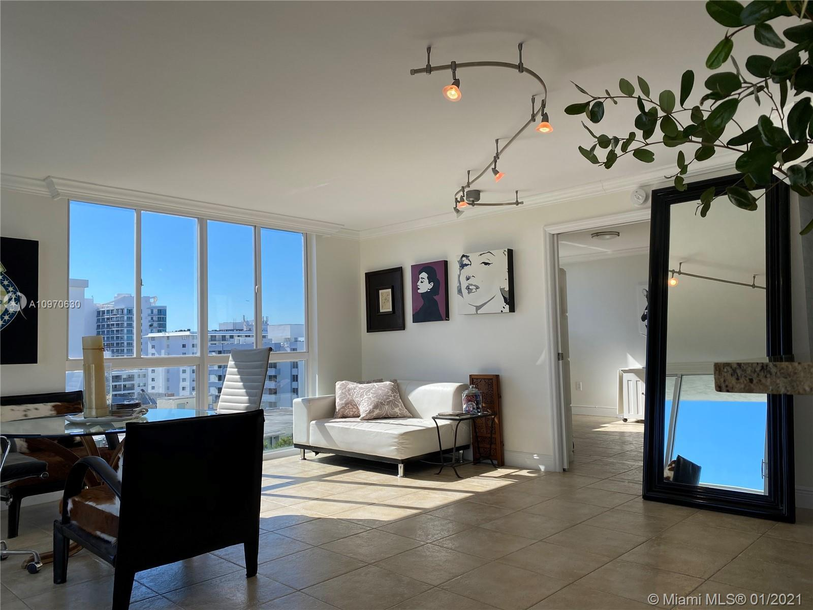Light filled and spacious 2 BD & 2 BA condo has an enviable location across the street from Trader J