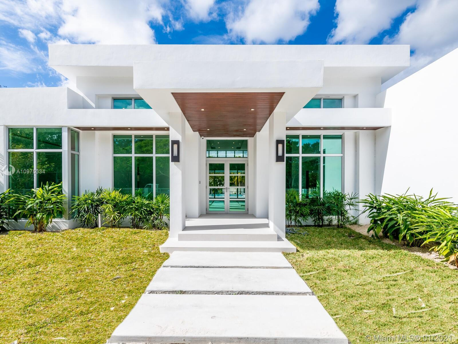 A BAUHAUS INSPIRED ONE-ACRE LOT, BY RENOWNED ARCHITECT MARK REARDON. SURROUNDED BY THE ELEGANT CORAL