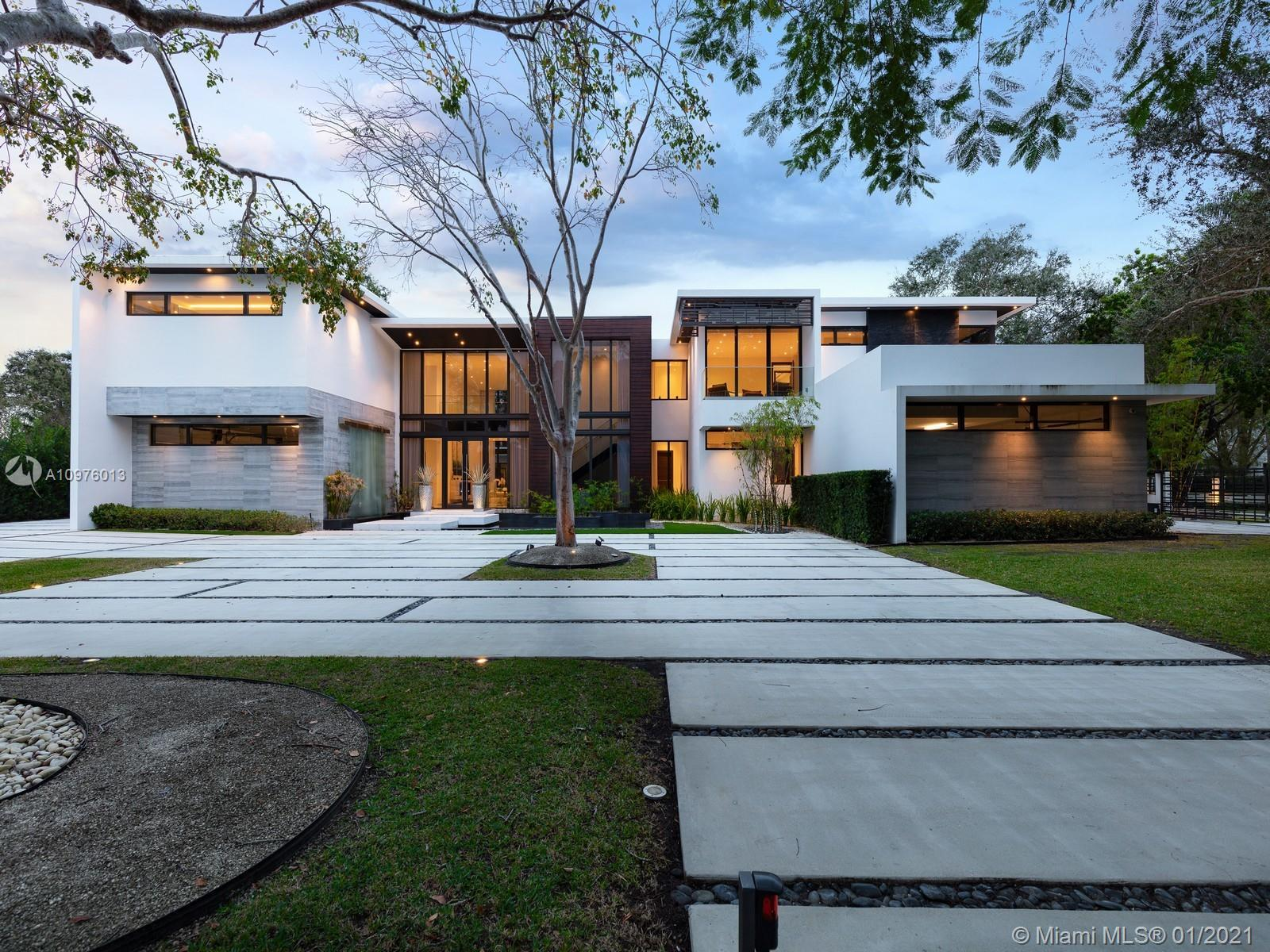Located in the prestigious, sought-after neighborhood of N. Pinecrest this NEW modern estate is a un