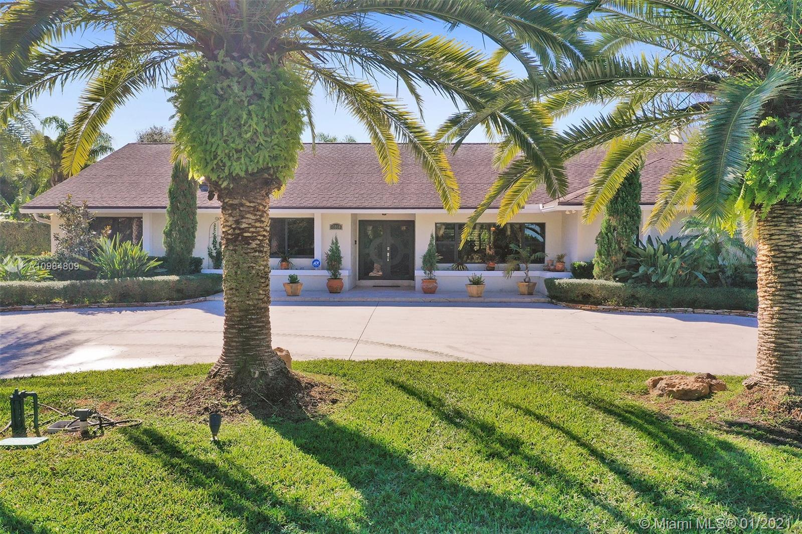 Welcome to this gorgeous home in Davie FL. Situated on a huge lot & professionally landscaped, this