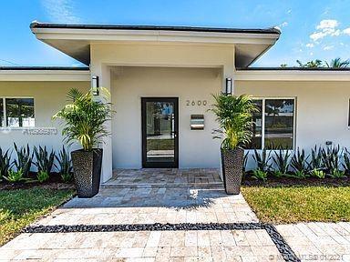 Spectacular redesigned/rebuilt 4BR/3BA/1HBA/2CG Coral Ridge residence originally designed and built