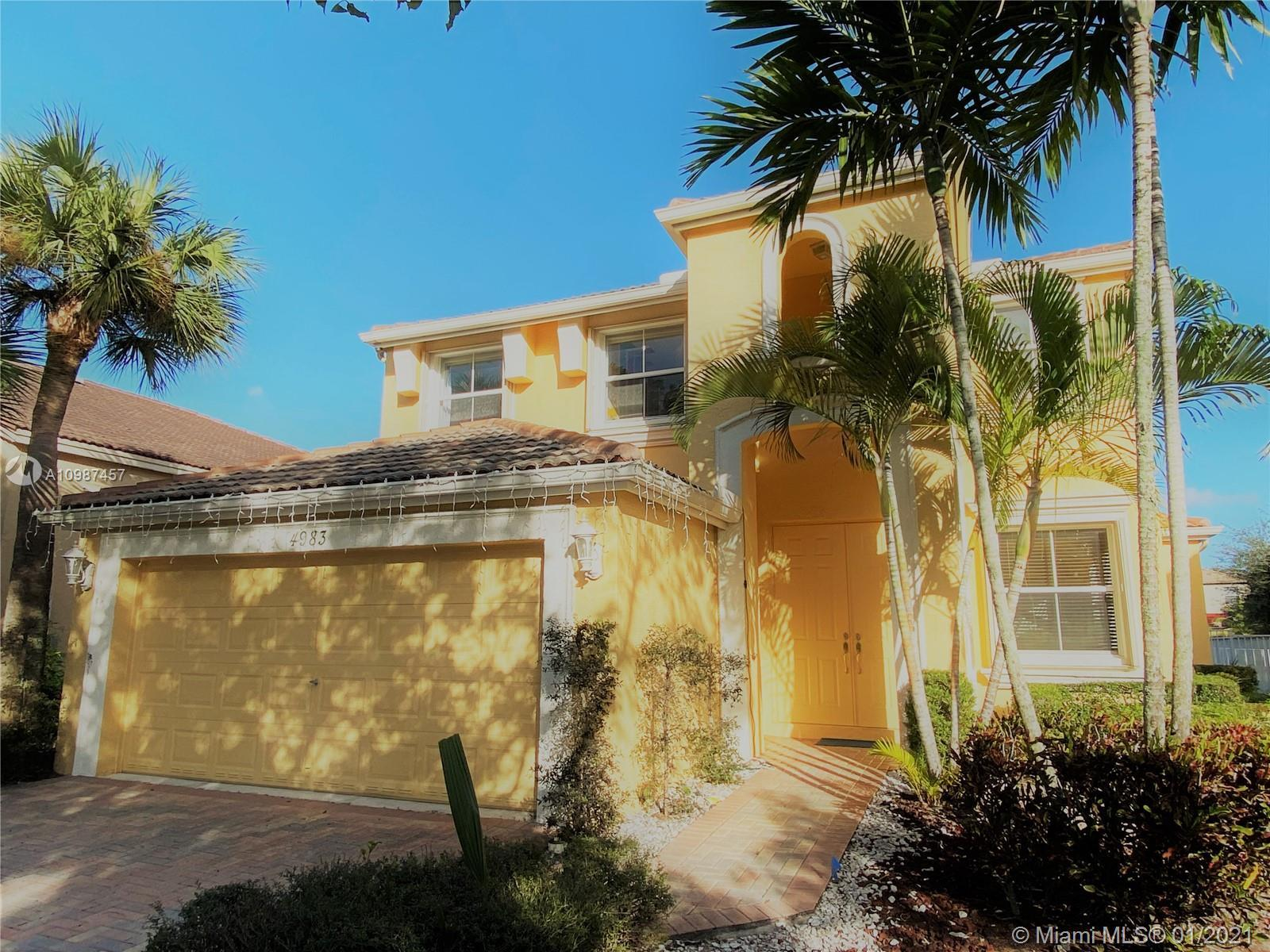 Spectacular 2-story home in a Resort Style Club House with first class amenities including, pools, h