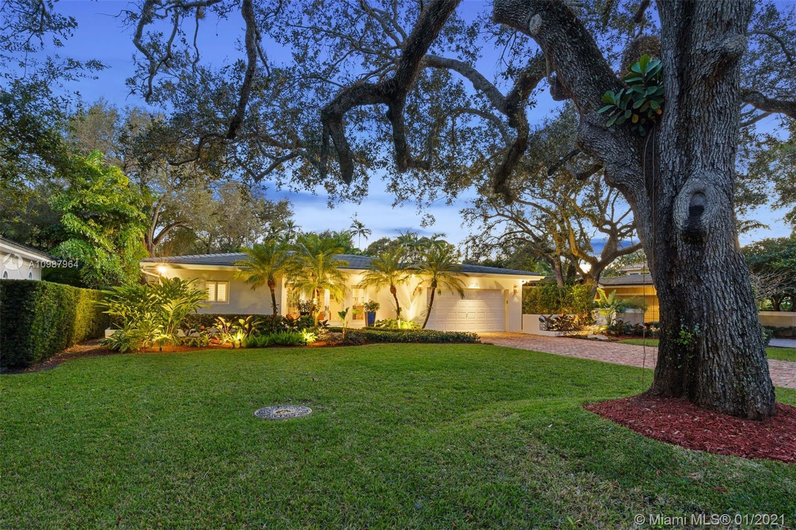 Immaculate one story pool home centrally located in one of the most desirable streets in Coral Gable