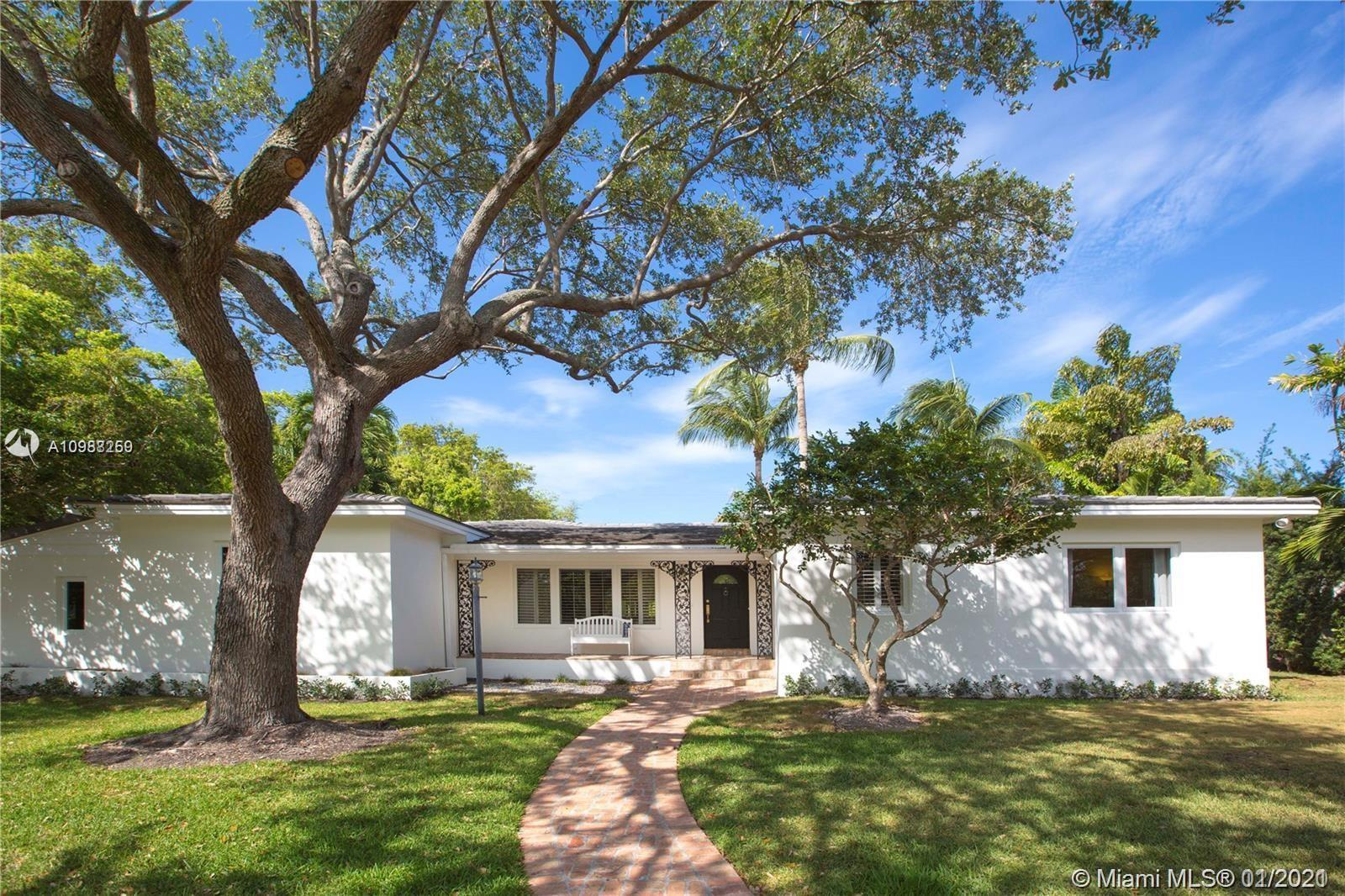 Fabulous, light and airy corner home on Riviera Drive, one of the most prestigious streets in Coral