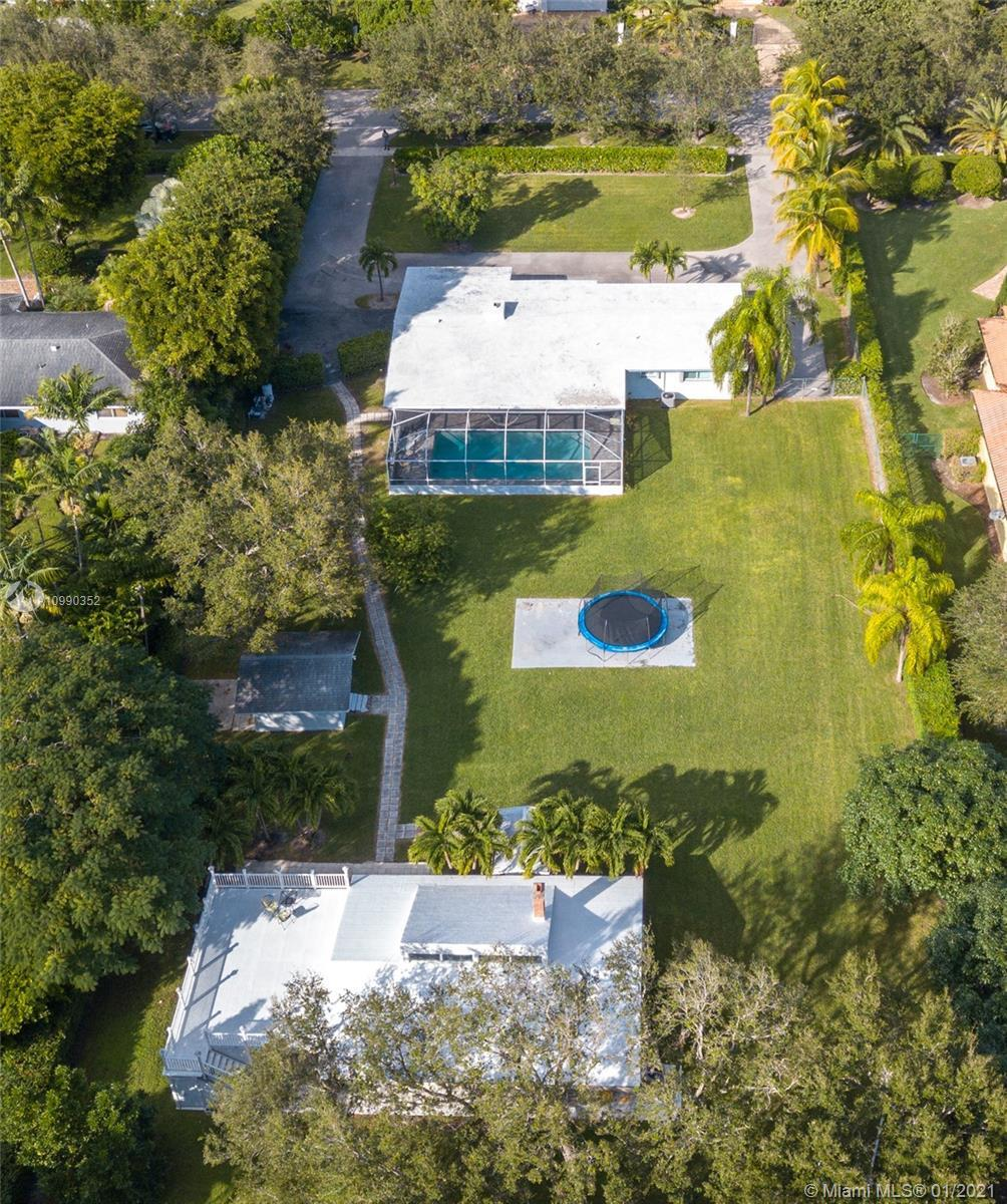 Two for one deal!   A remarkable pool house on Pinecrest on an acre lot size. The property consist