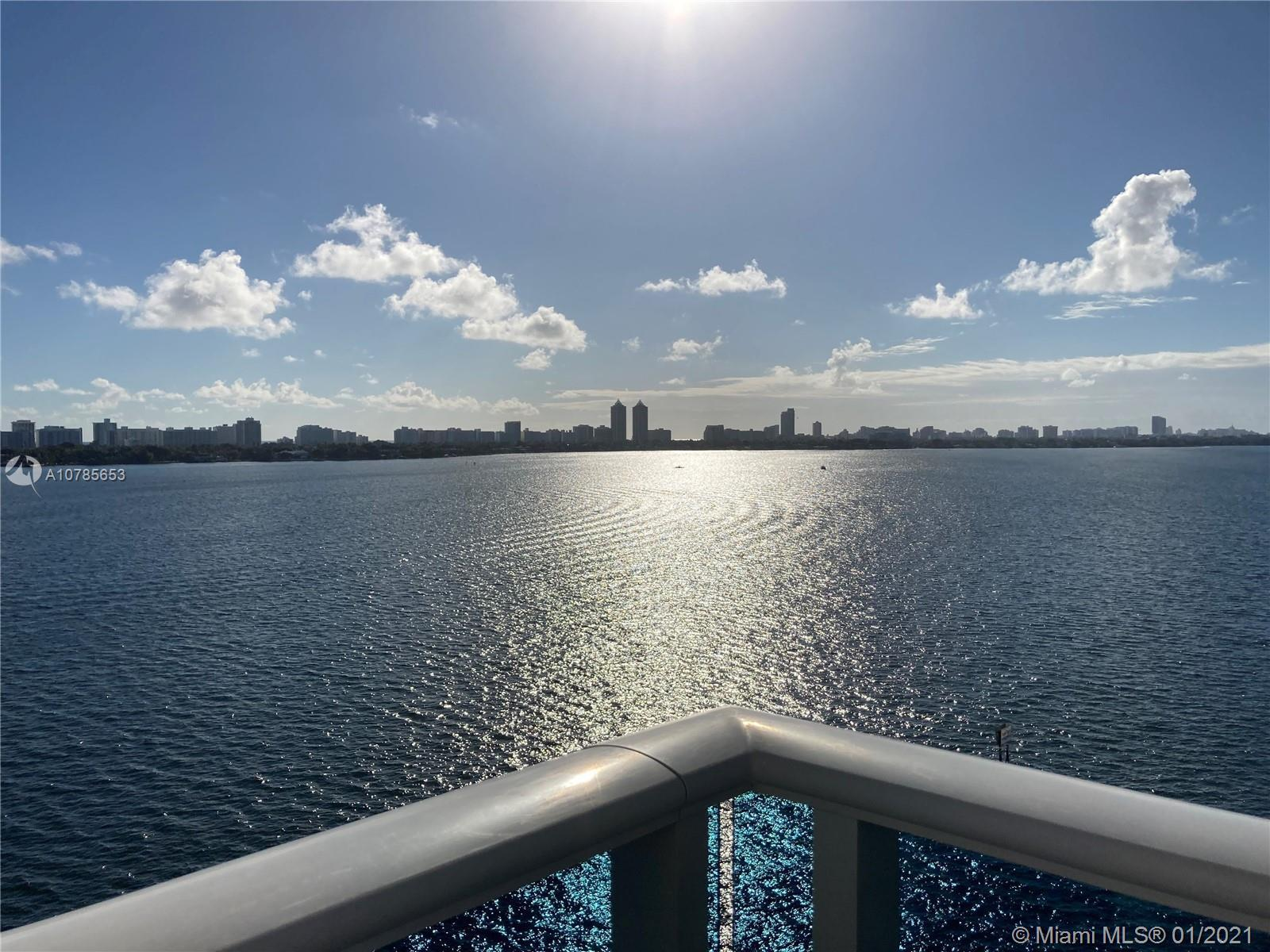 Gorgeous view right on Biscayne Bay with an  outstanding 3 bedroom where you can hear the water gent