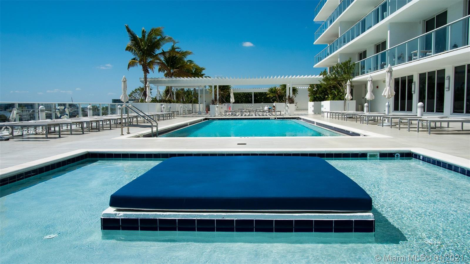 Feel the Luxury Living in a Boutique Style Condo with Spectacular Miami Bay views, 1 Master Bed, and