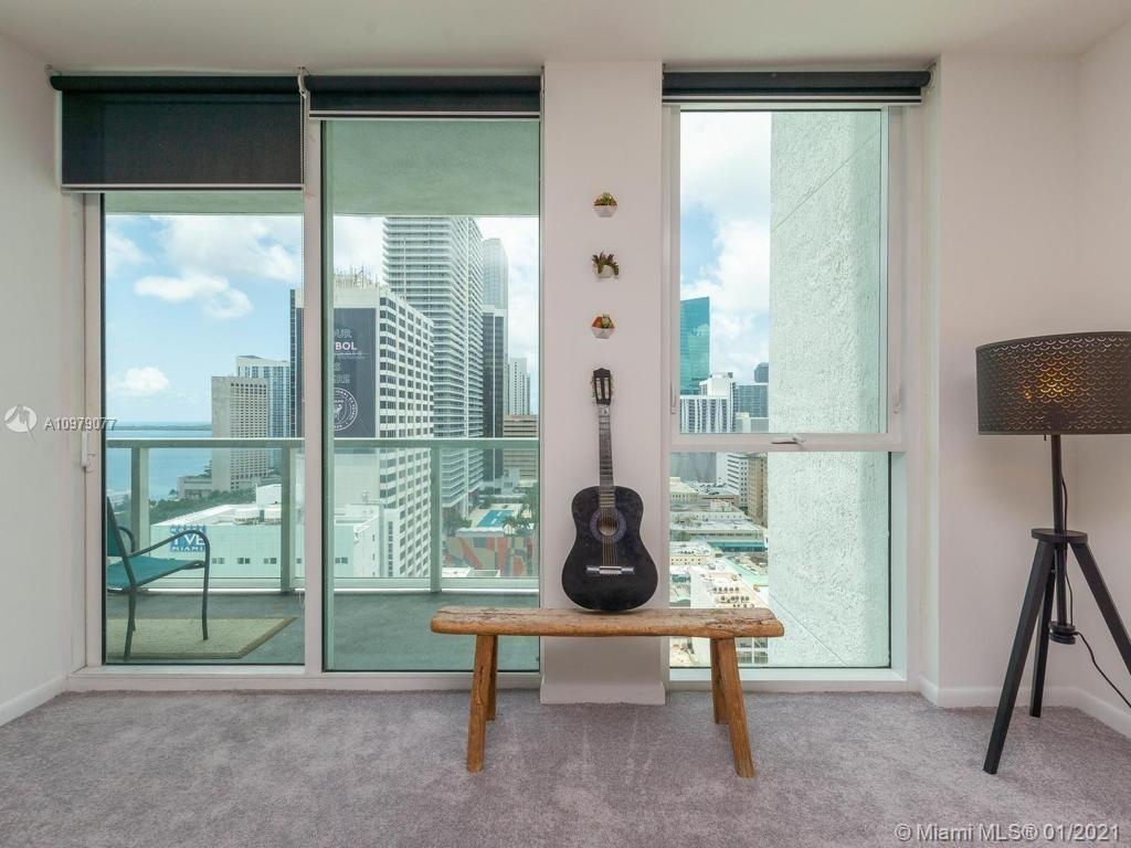 Imagine coming home every day to enjoy gorgeous Biscayne Bay and Downtown City views from your very