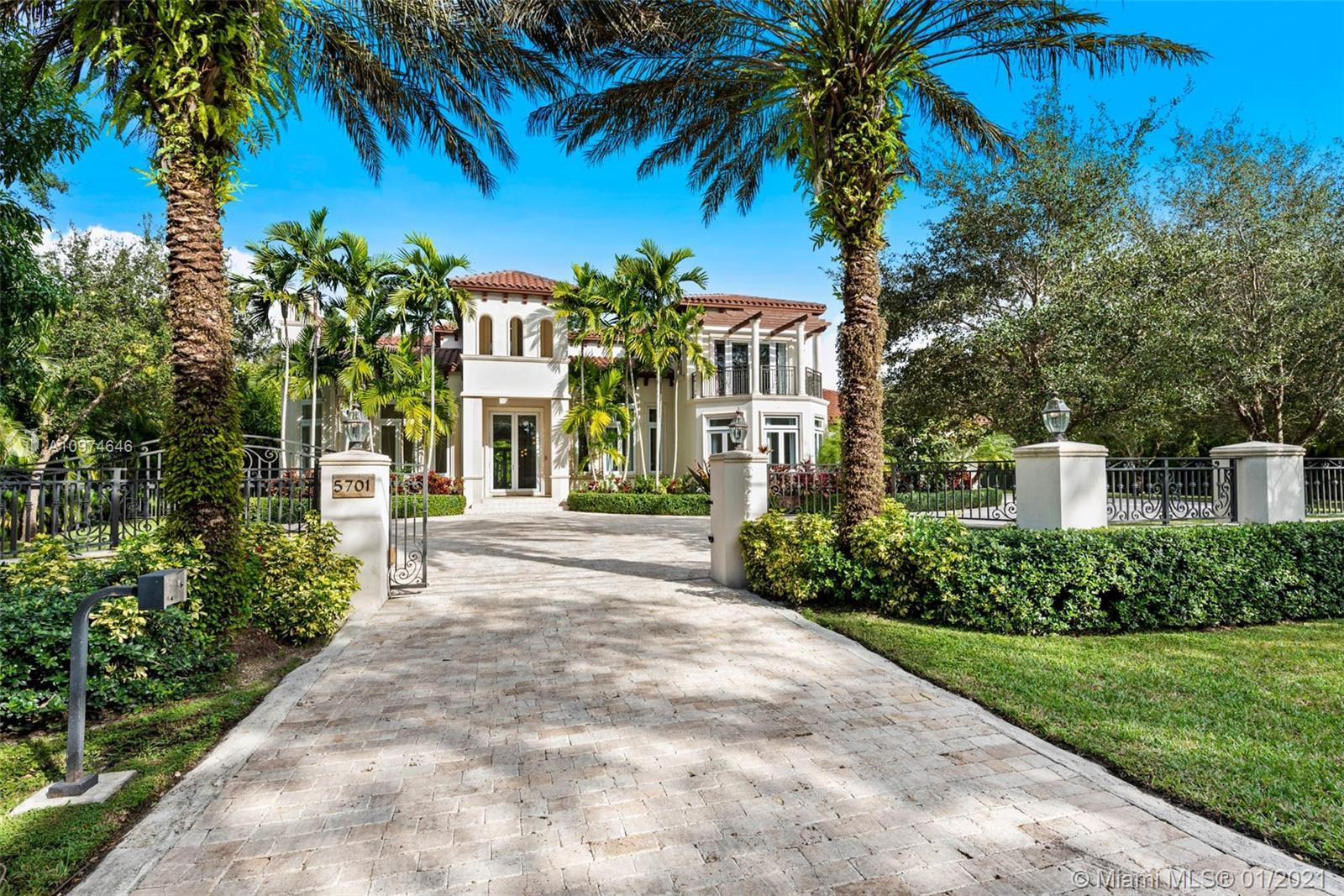 Superlative Mediterranean Masterpiece located on a stunning corner lot in coveted North Pinecrest. A