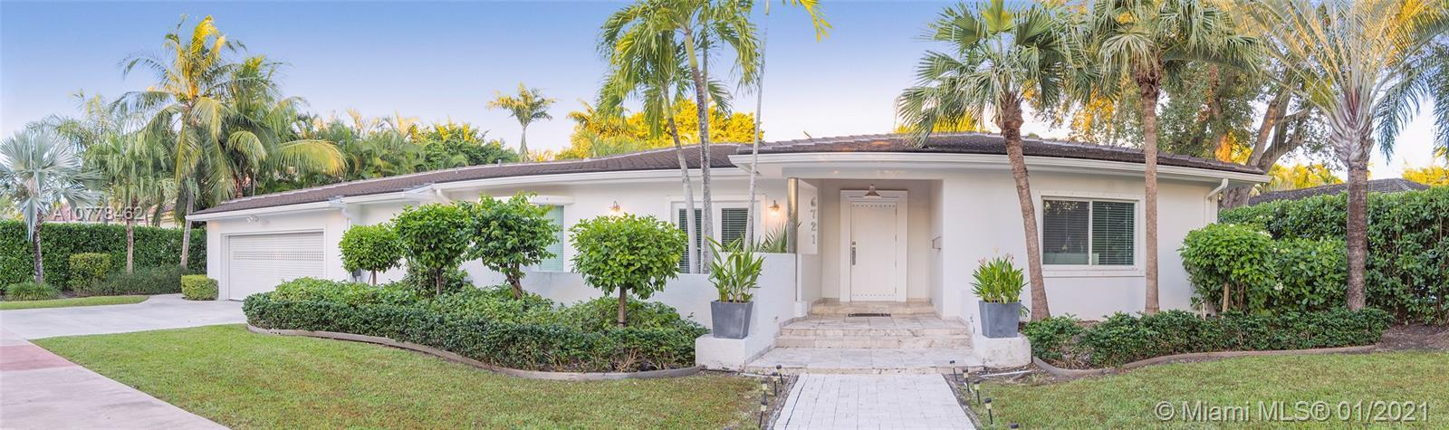 Come enjoy this updated 5 Bedroom, 5 Bathroom home in South Gables that sits on an almost 14,000 sq