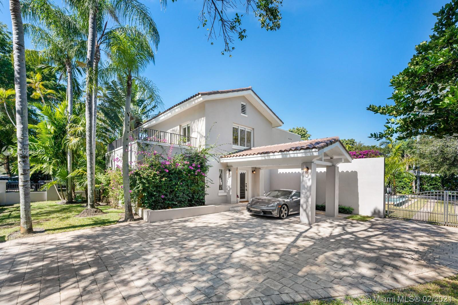 Elegant renovation recently completed! Home sits on a 10,000 sqft lot with a large pool and a guest