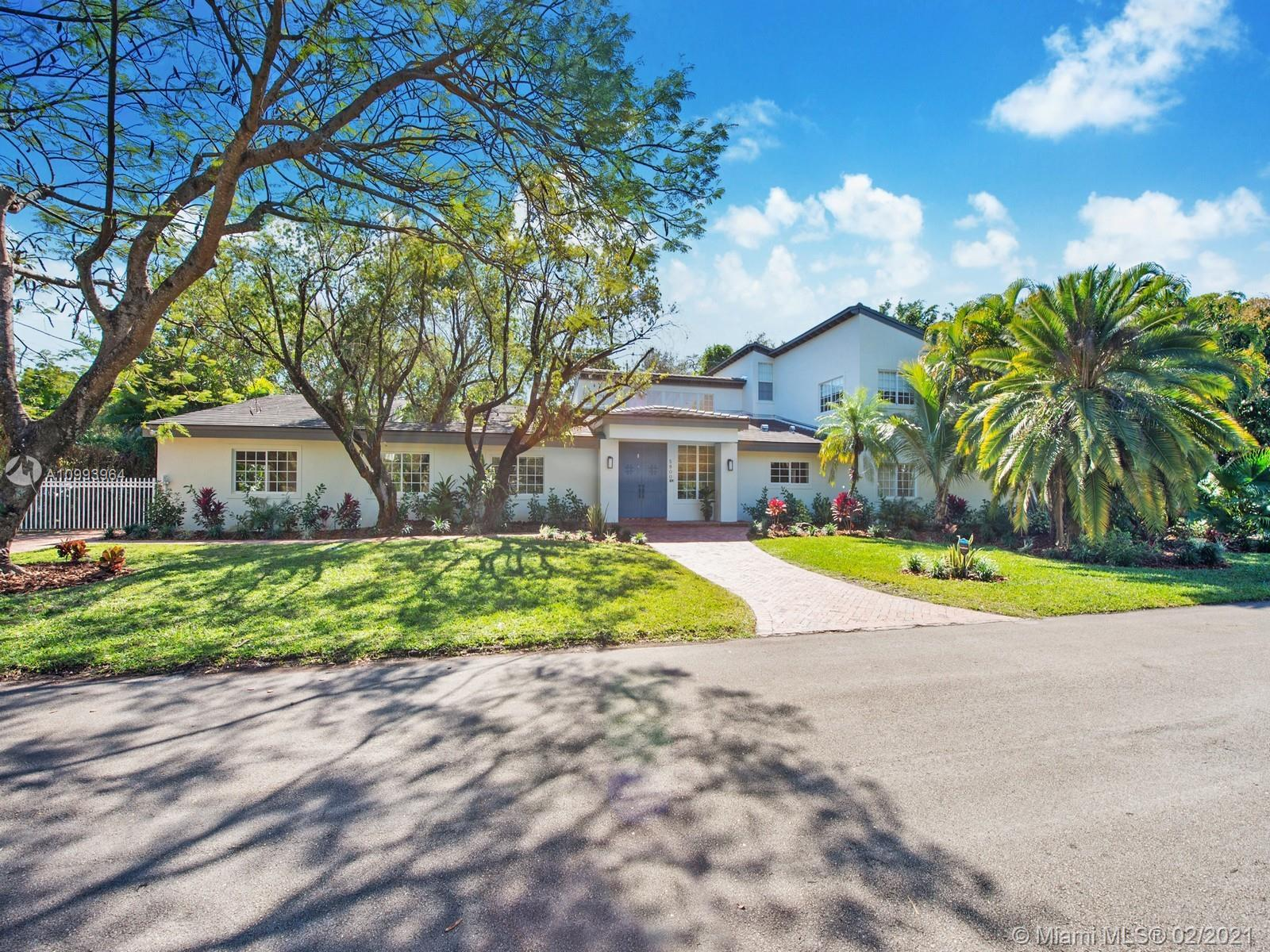 Gorgeous and completely renovated estate located in North Pinecrest. This 2-story tranquil residence