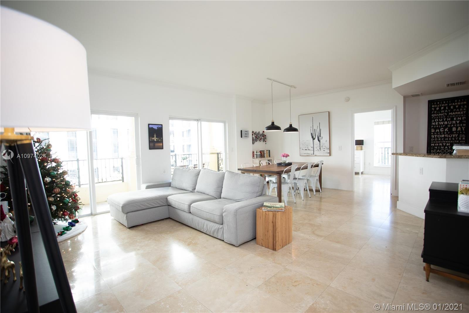 Coral Gables living at its absolute finest. This stunning and spacious two bedroom + Den corner unit