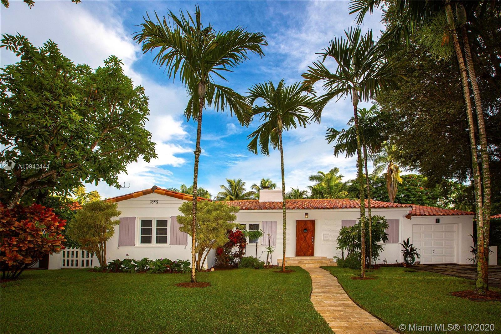 Spectacular deco home just blocks from the Venetian Pool. Fully updated 4-Bedroom 3-bath on a double