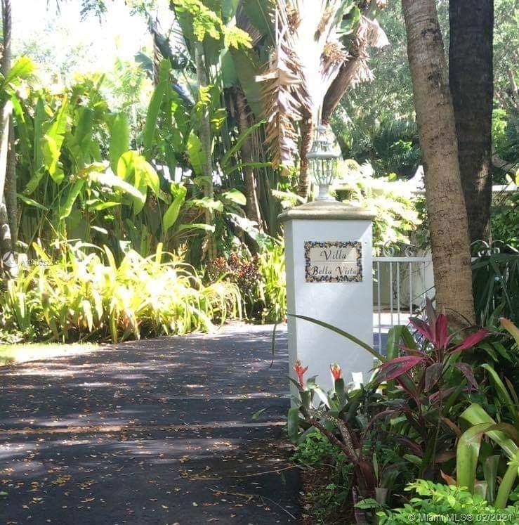 Rarely available 4/3 Mid-Century Modern home on an acre in North Pinecrest. Views to the lush tropic