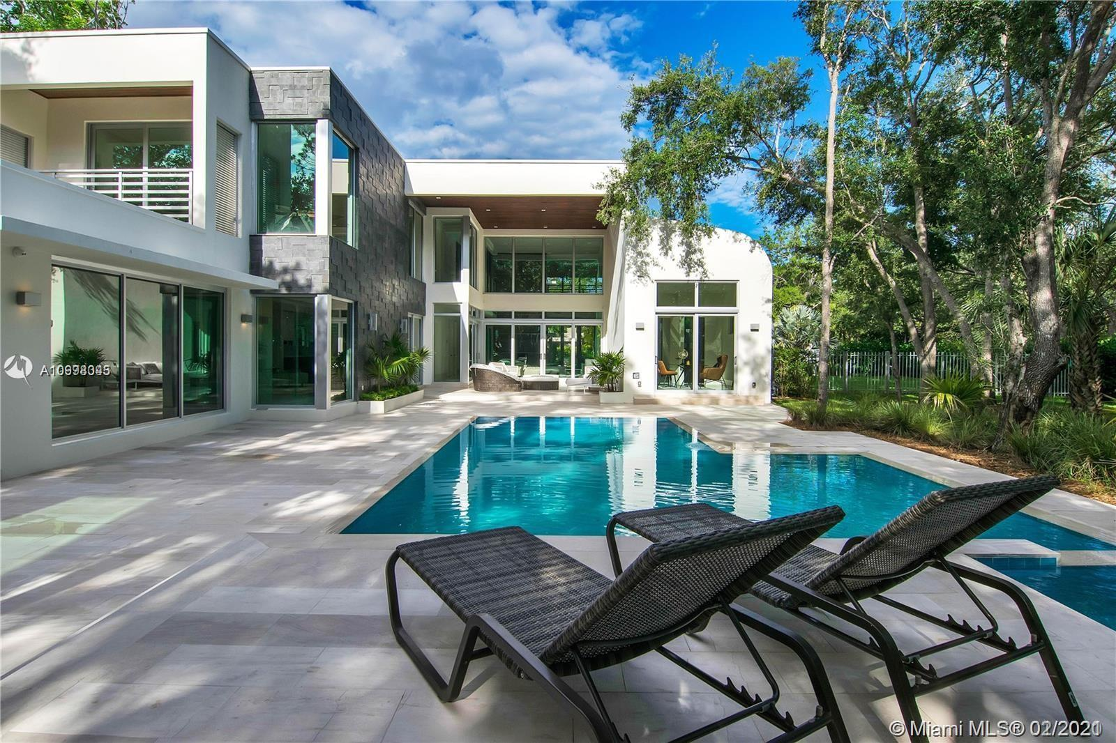 Moderism comes to Pinecrest in this 2 story amazing masterpiece designed by architect Ralph Puig. If