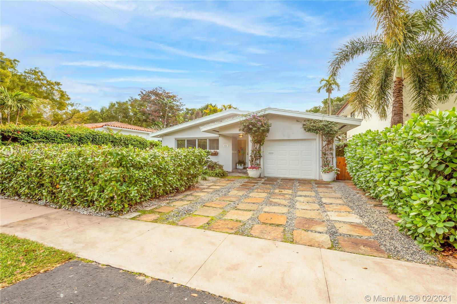 New Listing! Unique, 1959 mid-century two bedroom /two and a half bath home in South Gables just nor