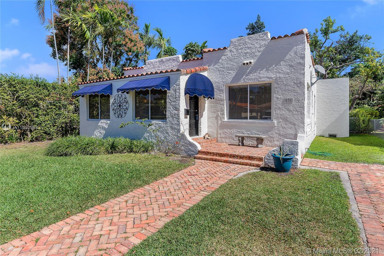 Old Spanish bungalow on a quiet tree-lined street in North Coral Gables. Light-filled living spaces