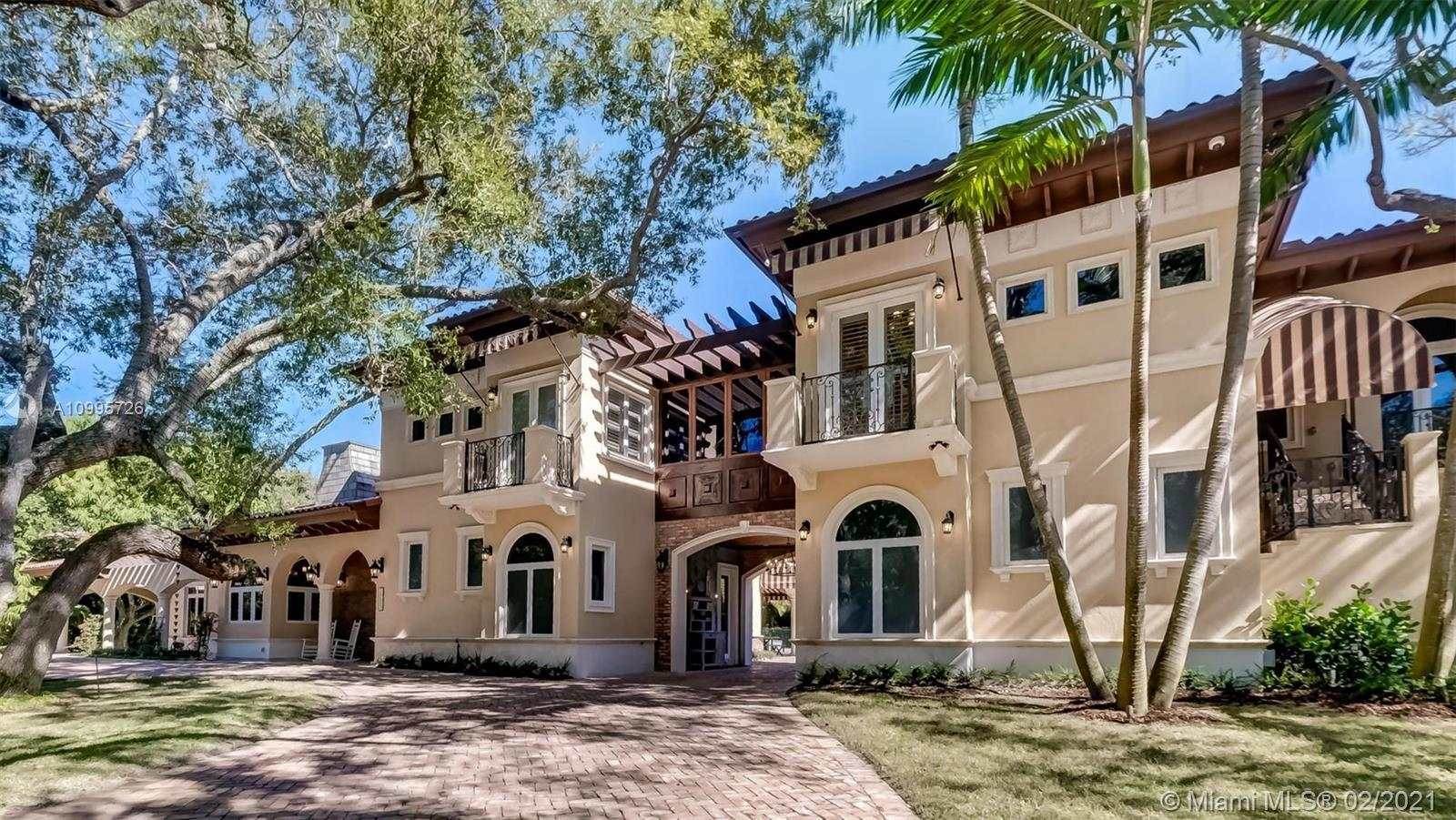Absolutely luxurious Custom Pinecrest Estate with incredible detail & quality. The 6,100 sq ft resid