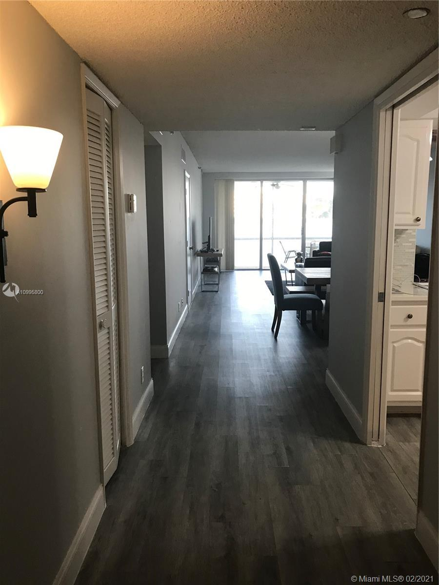 Spectacular first floor unit . Updated kitchen and large bedrooms. Golf course view with screened pa