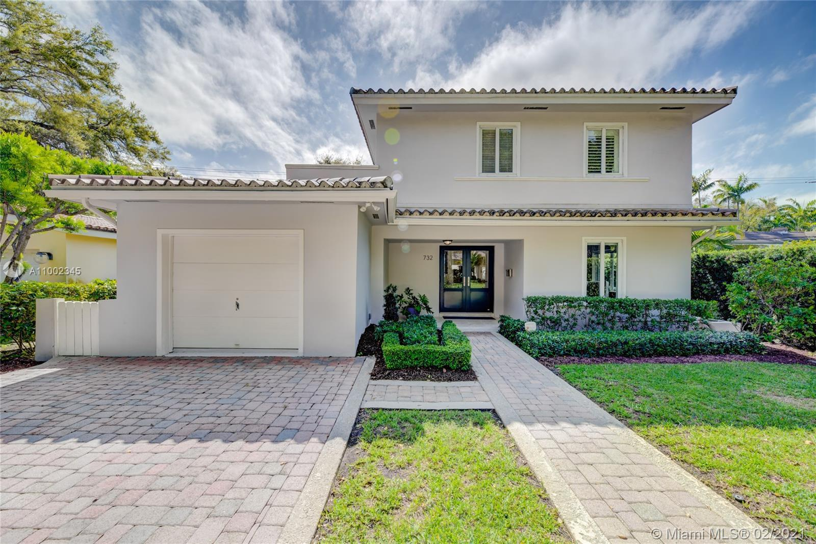 An amazing 2 story home with great street presence in a sought after Coral Gables on a tree lined st