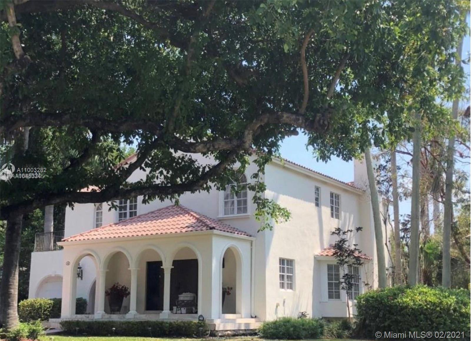 Beautiful two story gem on a lush corner lot in the Islands of Cocoplum.  Four beds, three/one baths