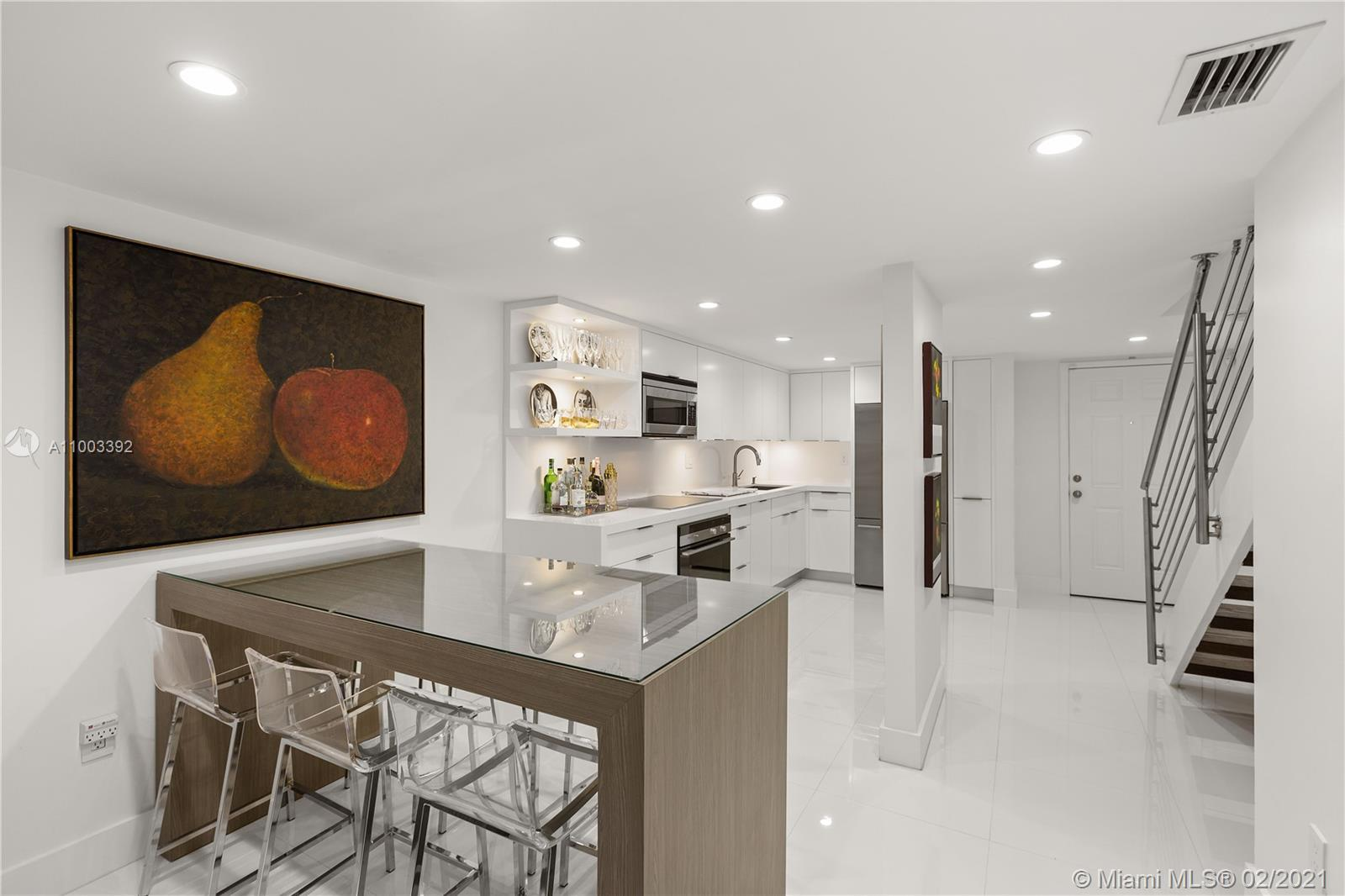 Completely renovated two-level turnkey residence. The first level offers an open concept floor plan