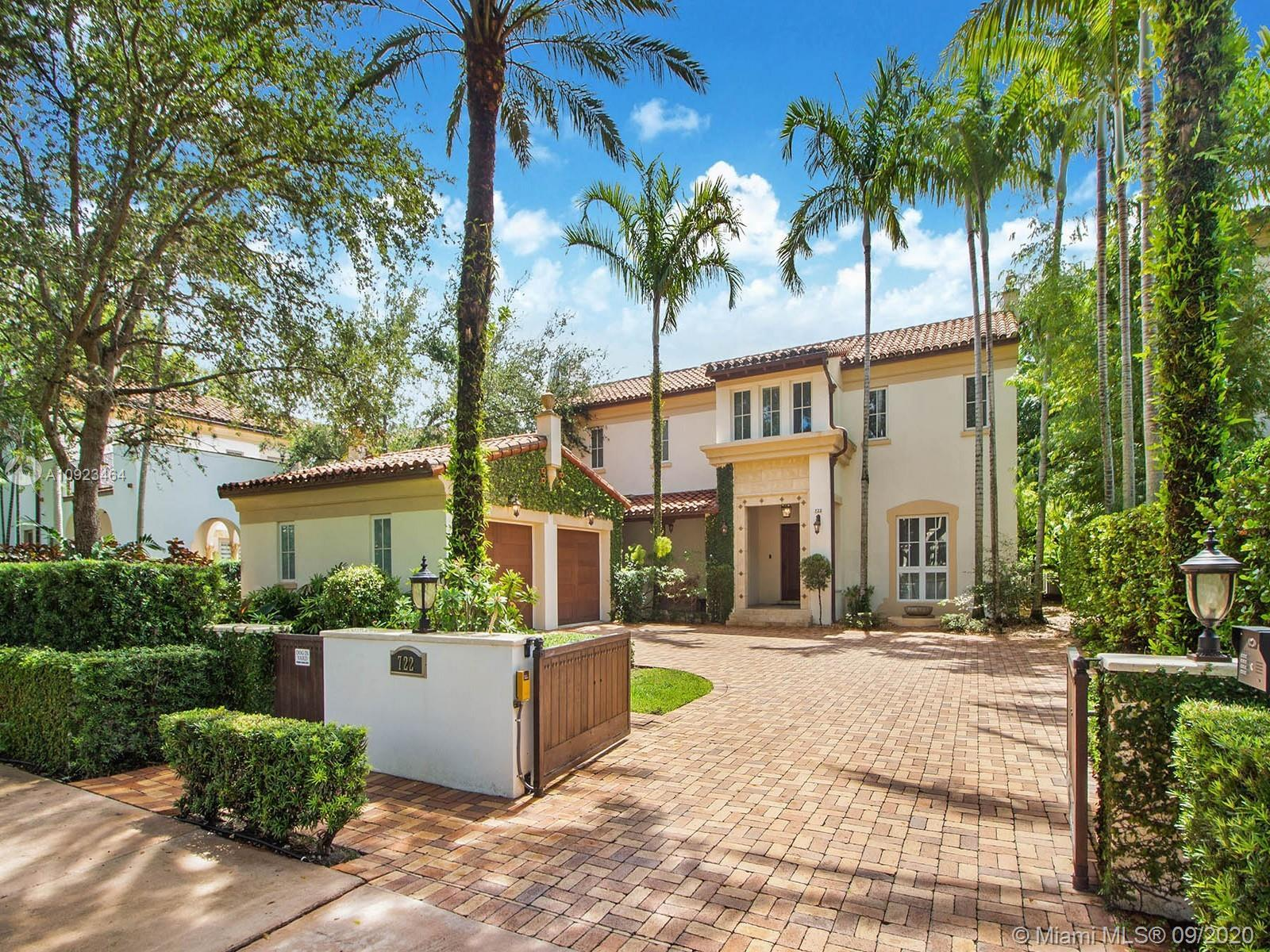 This Spanish manor in Coral Gables is utter perfection. Located in Casa Sevillanas Village surrounde